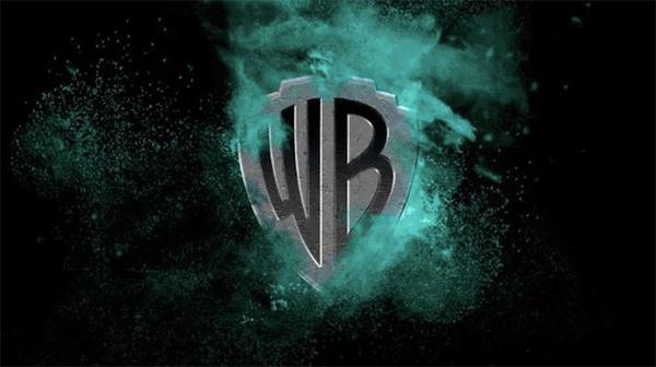 Green Flame Warner Brothers Logo by Pentagram